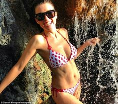 Wet 'n' wild: A bikini-clad Dannii Minogue cools down in a waterfall after a hot day filming in #Barbados