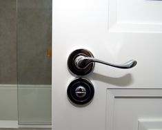 Polished chrome door handles fitted to a new bespoke wooden internal door