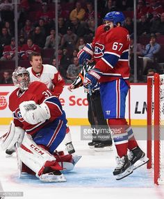 Max Pacioretty of the Montreal Canadiens receives a shot on his chest in  front of the net against the Detroit Red Wings in the NHL game at the Bell  Centre ... 93623efbb