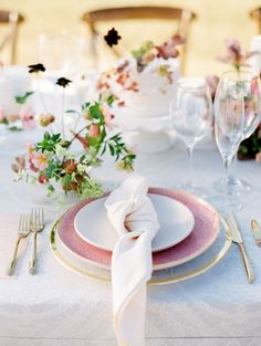 pretty table setting with a knotted linen napkin