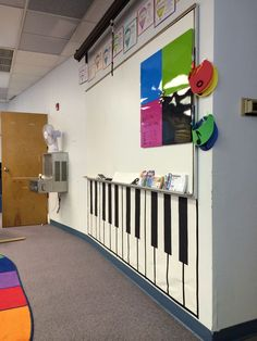 Music room piano. Dollar store gift wrap, black construction paper and electrical tape.