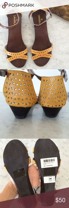 Leather cut out sandals New! Super cute perforated mustard leather sandals with sleek cut outs, ankle straps, and rubber soles. Your summer staple. No trades. Tantra Shoes Sandals