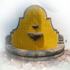Tile wall fountain - love the style with different tile