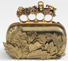 Google Image Result for http://www.extravaganzi.com/wp-content/uploads/2011/02/Alexander-McQueen-Four-Finger-Flower-Leather-Clutch-1.jpg