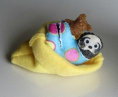 Sloth in pajamas with Teddy bear and fleece snuggle bag