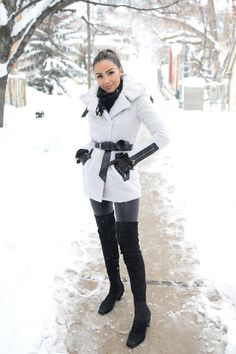 Olivia Culpo wearing Mackage Kinsley Merino Wool Coat with Belted Waist, Strathberry Midi Leather Tote, Kate Spade New York Bow Logo Gloves, J Brand L8007 Edita Leather Pants and Nicholas Kirkwood Pollypetal Riley Over the Knee Boots