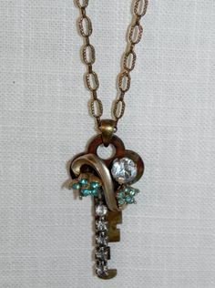 Pretty OOAK Vintage Steampunk Repurposed Brooch Key Necklace. $38.00, via Etsy.