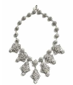 Elegant & exquisite, this filigree Statement necklace features silver filigree medallions that link together perfectly to create a stunning statement piece. Sparkling Swarovski crystals mingle in an eye-catching setting. With its perfect balance of classic elegance and fashion forward chic, this piece can