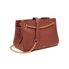 Shop the Winsley in Antique Pink Grained Lambskin Leather at Mulberry.com. Combining elegance with practicality, the Winsley has beautiful chain, eyelet and zip detailing, and multiple interior compartments for every day essentials. The clever chain attachment is easily adjustable to switch between wearing cross body or on the shoulder.