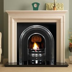 The PureGlow Wenlock Agean Limestone Surround with Jubilee Highlighted Cast Iron Arch consists of the Wenlock Agean limestone mantel, Jubilee cast iron arched insert with cast back, x black granite hearth and optional gas fire or elec Small Gas Fireplace, Wooden Fireplace Surround, Fireplace Box, Direct Vent Fireplace, Fireplace Suites, Vented Gas Fireplace, Cast Iron Fireplace, Victorian Fireplace, Marble Fireplaces
