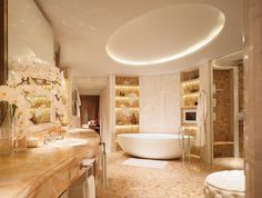 Apaiser's bathware in the award winning 'Royal Penthouse' of the Corinthia Hotel, London. The 'Haven' Eco stone bath is surrounded by stone and ceramic tile, as well as splashes of marble and silver fittings. This truly is a luxurious bathroom