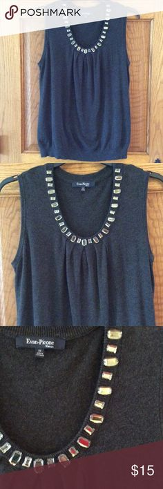 Grey knit sleeveless shell Grey knit sleeveless shell. Beautiful gem stones at neck line. Gems are not heavy. Like new. Measures 23 pit to pit Evan Picone Tops Blouses