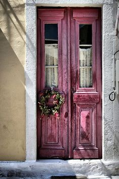 Old, weathered raspberry red/maroon/dark pink colored double doors with a wreath in Kefalonia, Greece. Old, weathered raspberry red/maroon/dark pink colored double doors with a wreath in Kefalonia, Greece. Cool Doors, The Doors, Unique Doors, Windows And Doors, Front Doors, Door Knockers, Door Knobs, Door Handles, Porte Cochere