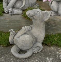 Ace Rat by Dixie's Brookfield Garden. $41.00. Ace is a great Christmas decoration for the home.. Ace can double as a doorstop.. The most appealing RAT you'll ever see!. Two 'rats' make remarkable bookends!. Ace and his buddies,Rodney and Ratsmore make a fun group for the garden. A rat sculpture with terrific appeal, cast in fiber-reinforced concrete with a hand applied antique wash.U.S. made.