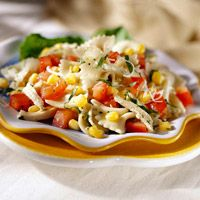 Corn and Tomato Pasta Salad - Excellent! Nice refreshing salad with fresh corn and tomatoes. Pesto is a great addition to the vinaigrette.
