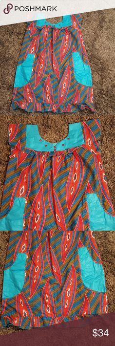 "Handmade African Dress - Custom This is a used once, great condition African dress that was handmade. No stains or tears. Two pockets. Approximately 42"" long, 23"" at armpit & 29"" (loosely) at waist. This is a plus or maternity size dress. Handmade Dresses"
