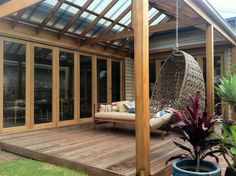 Yes! This is what I want for our deck/pergola - wooden beams, pitched roof, clear Perspex to keep it light
