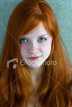Head Shot of Young, Red Headed Woman with Green Eyes Royalty Free Stock Photo