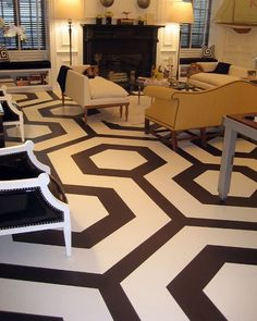 Painted Concrete Floors - don't exactly like this pattern but it gives inspiration for something fun in the basement if we wanted to lighten up the space.