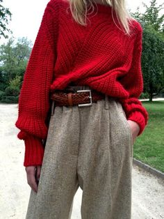 Trouser and big red sweater. 70s inspired fashion trend.
