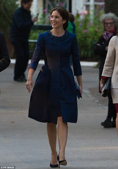 Royally elegant: Crown Princess Mary of Denmark looked resplendent in navy as she arrived at the Tivoli Concert Hall in Copenhagen, Denmark, for the final concert of Melbourne Symphony Orchestra's European tour on Tuesday