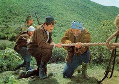"""Der Schut (1964) with Renato Baldini. German postcard by Heinerle Karl-May-Postkarten, no. 9. Photo: CCC / Gloria. Publicity still for <i>Der Schut/The Yellow One</i> (Robert Siodmak, 1964). Caption: """"'Hier Barud, nimm mein Messer!' -  'Ja, so geht's besser! Sollte jetzt Jemand lust haben, uns zu verfolgen, dann braucht er nur über diese Brücke zu kommen!' - """" (Barud, take my knife! '- 'Yes, now it gets better! If someone should like to persecute us, then he just needs to come across the…"""