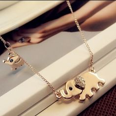 "Mom and baby elephant necklace Stunning gold plated mom and baby elephant necklace. Chain measures 16"" along with a 0.75"" elephant following a 0.25"" baby elephant. Thank you for visiting my closet. Please let me know if you have any questions. Coming soon. Jewelry Necklaces"