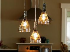 10 Fun Ways to Decorate With Mason Jars and Wine Bottles: You can make so many things with a bottle cutter. For instance, these kitchen pendants were crafted from three old wine bottles.  They were cut just below the neck, wrapped in decorative wire then fitted with electrical fixtures. Design by Joanne Palmisano. From DIYnetwork.com