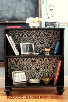 Add feet and wallpaper or fabric to a simple cheap bookshelf to instantly upgrade it to something a little more fancy!
