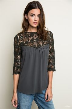 I'm not usually a fan of lace, but I like the cut on this shirt. Relishclothing.com