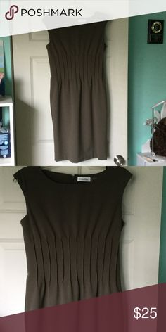 """Lovely olive green CK fitted dress Like new lovely designer dress. Pleats in midsection make it form-fitting and figure flattering. It is fully lined and measures 37"""" in length. Very nice color. Calvin Klein Dresses Midi"""