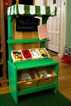 Play Food Market.  I want to make one of these and fill it with felt fruit/veggies.