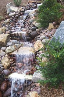The 2 Minute Gardener: Photo - Water Feature on a Slope