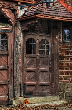 old carriage house door, Michigan I love the character of these time worn doors that saw so many people come and go.