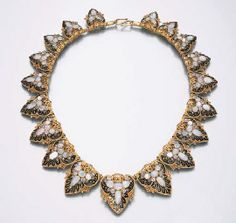 AN ART NOUVEAU OPAL NECKLACE  ~   Designed as opal, diamond and black enamel graduated palmettes, with openwork detail, mounted in gold, circa 1895