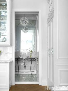 #Bathroom a venetian etched mirror,Kohler vessel sink paired with a console plus an elegant view when the door is open.