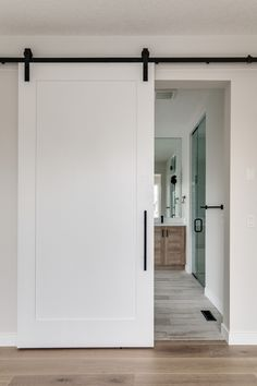 How elegant is this white sliding barn door with black hardware We LOVE the simplicity Barn Door Designs, White Barn, Interior Barn Doors, Modern Barn Doors, Cheap Home Decor, Home Remodeling, New Homes, House Design, Downstairs Bathroom
