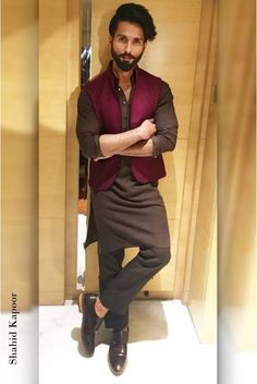The brown Chinar Kurta with an asymmetrical hemline flaunts its gold buttons on the cuffs. Paired with the wine, silk Malhar Bandi, embroidered all over and cotton linen brown pants Mens Indian Wear, Mens Ethnic Wear, Indian Groom Wear, Indian Men Fashion, Mens Fashion Suits, Indian Man, Fashion Wear, Wedding Kurta For Men, Wedding Dresses Men Indian