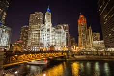 Chicago River Photo by Peter Ciro -- National Geographic Your Shot #tribune #chicagoriver #wrigley #michiganave Shot over looking the Chicago River with the Wrigley Building and Tribune Tower on Autism Awareness Day.