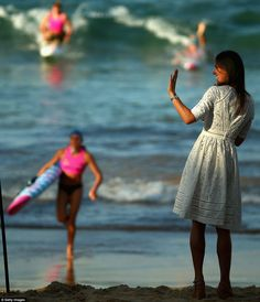 The Duchess was in a cheerful mood, waving at the thousands who had gathered to witness the Royals' day at the beach