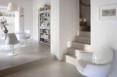 Suelo de microcemento con muebles clásicos  Micro cement floor with designer  classic furniture.