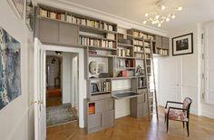 rolling ladder, shelves over the doorways and an integrated desk...spot on design