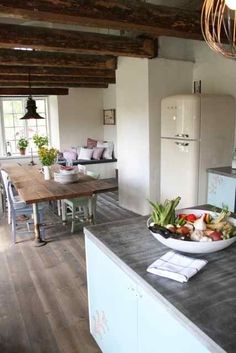 Farmhouse Charm, I love the fact that they have used re-purposed poles on the table as legs and the colour of them plus the exposed timber beams.