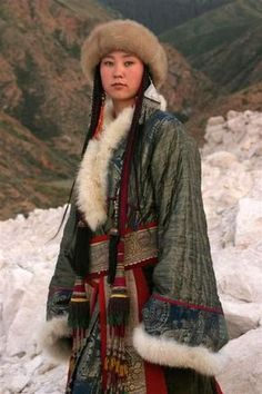Kirghiz woman in traditional costume; Kyrgyzstan, Central Asia