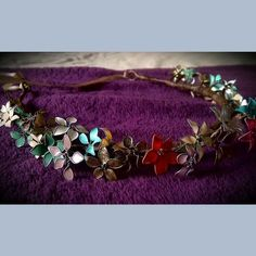 Crown of wire flowers and nail enamel by Louise Roberts  - featured on Jewelry Making Journal