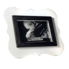 <div>Your photo will stand out in this rustic-looking picture frame. The black fillet is raised ...