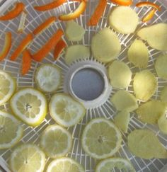 """How to dry ginger and other fruit (in the oven, at the lowest possible setting, from orange peel: """"Spread the strips in a single layer on a parchment-lined baking sheet and put them in a 250 F oven until you see them start to curl - 15 to 25 minutes."""")"""
