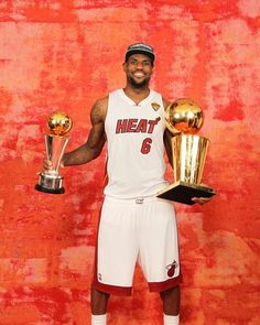LeBron James #6 of the Miami Heat poses for a portrait with the Larry O'Brien and Finals MVP Trophy after winning the Championship against the Oklahoma City Thunder during Game Five of the 2012 NBA Finals - http://www.fansedge.com/LeBron-James-Miami-Heat-NBA-Finals-Game-5-6212012-_-820726170_PD.html?social=pinterest_nbafinals_lebron