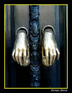 dual door knockers.  Sevilla  by Enrique Flores
