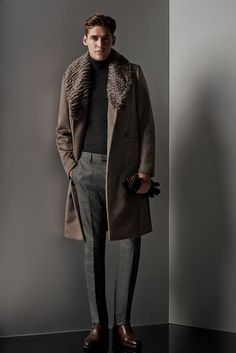 Wear a brown fur collar coat with grey suit pants for a classic and refined silhouette. Dark brown leather chelsea boots will add a new dimension to an otherwise classic look. Shop this look for $1,278: http://lookastic.com/men/looks/turtleneck-fur-collar-coat-gloves-dress-pants-chelsea-boots/4923 — Charcoal Turtleneck — Brown Fur Collar Coat — Dark Brown Leather Gloves — Grey Dress Pants — Dark Brown Leather Chelsea Boots